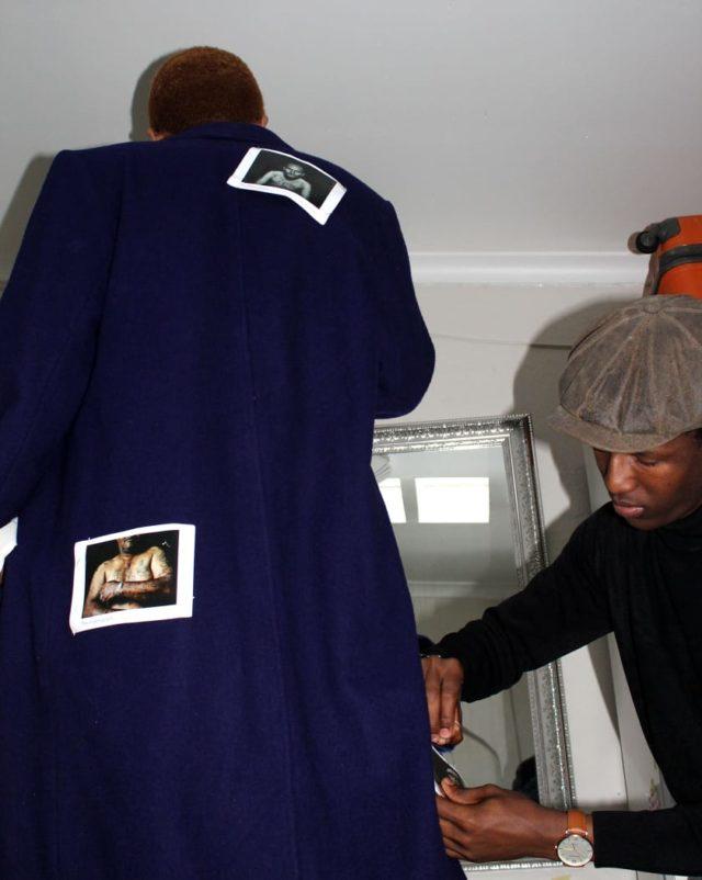 Lebogang Motsagi on the right working on one of his garments. Photo by Lebogang Motsagi