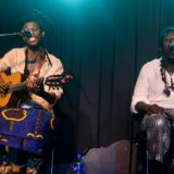 Artist Sibusile Xaba on stage with Neftali on the right. Photo by Sip The Snapper