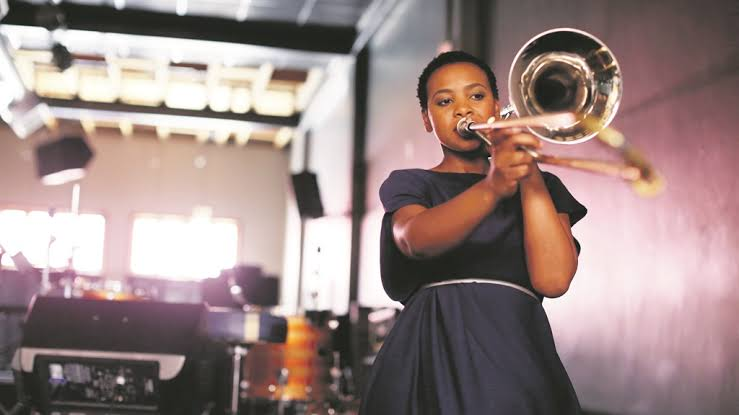 Siya Makuzeni blowing her trombone. Photo by City Press