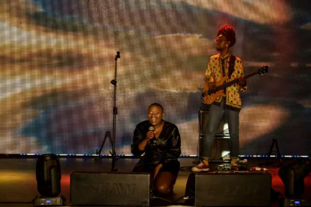 Zoe Modiga performing at Constitution Hill, with Banda Banda behind her. Photo by Sip The Snapper