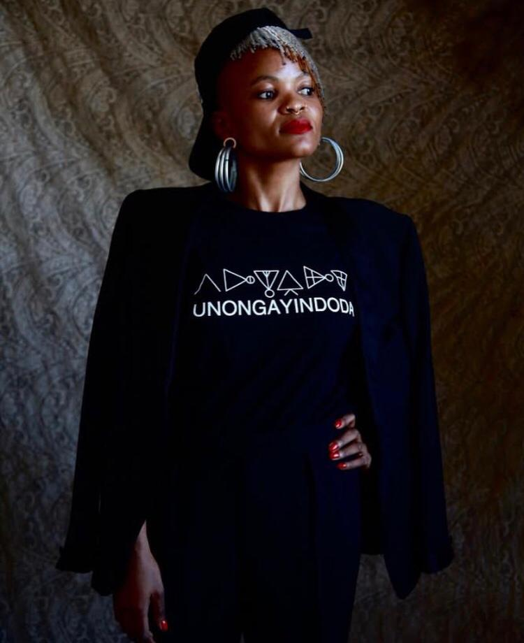 THA WOMAN BEHIND THA THA BRAND: Thando rocking one of her U Ts. Photo by Norman Maake