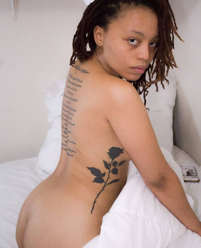 THE INFAMOUS FLOWER TAT: Lelo posing for the camera in her bed.Photo by Panda @iamkingpvnda